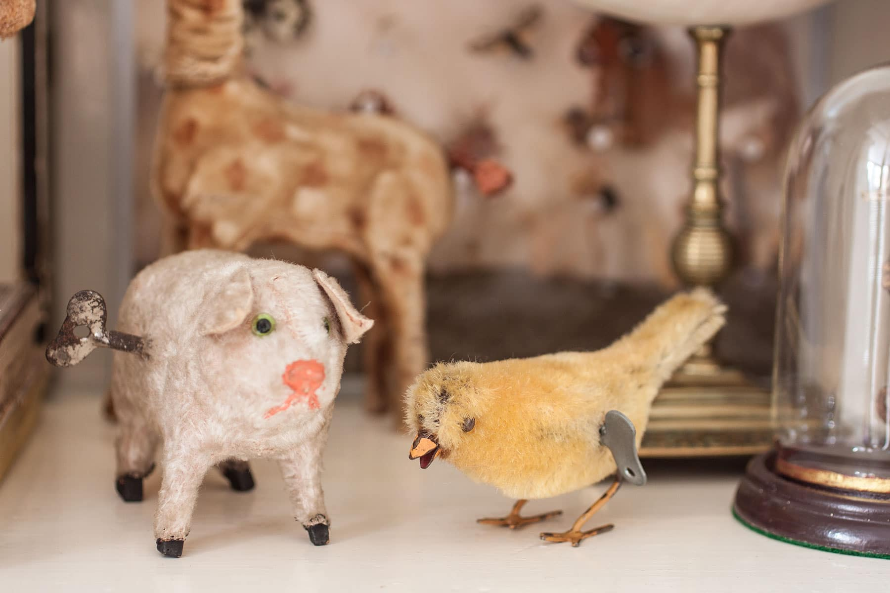 Vintage wind up pig and canary